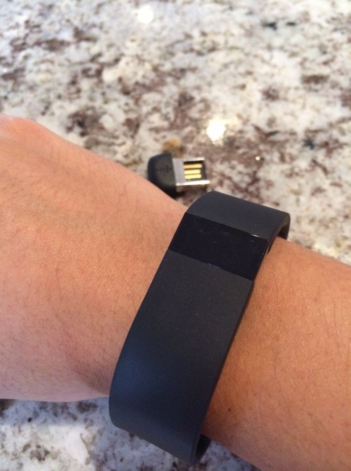 Fitbit Force and the dongle that sits in your computer so it syncs